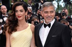 Amal Clooney babapocak