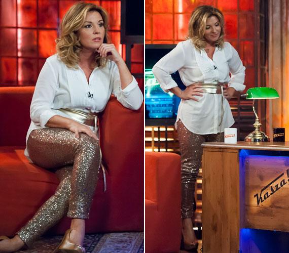 Liptai Claudia idén márciusban a Kasza! című műsorban viselt egy feltűnő, aranyszínű, flitteres nadrágot. Hozzá egy egyszerű, fehér blúzt, aranyszínű övet és lábbelit húzott.