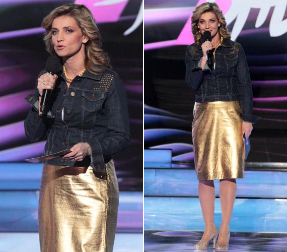Az első elődöntőben egy kissé furcsa összeállításban láthattuk: az aranyszínű ruhához és színben hozzá illő kiegészítőhöz arany szegecsekkel díszített farmerkabátot viselt.