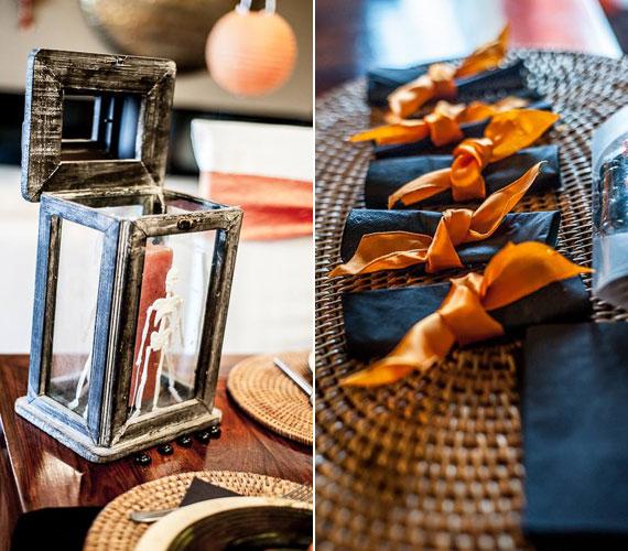 Az álló mécsestartóba csontváz került, a sötét színű textilszalvétákat a sütőtökök narancsszínében pompázó masni kötötte össze - Halloween elemei.