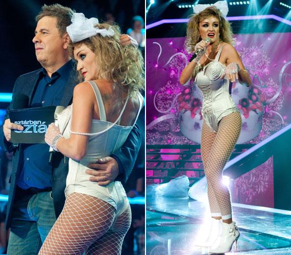 2013-ban, a műsor első szériájában Szandi is megmutathatta, mire képes a színpadon egy-egy átváltozás során. Ezen a fotón ugyanolyan ruhába bújt, mint amilyenben Madonna korábban nagy port kavart.