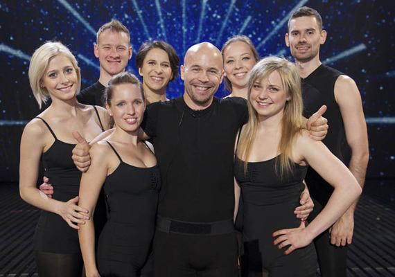 A Szűcs Zoltán által alapított Attraction formáció 2007-ben a Csillag Születik színpadán tűnt fel, de ott az énekesek mellett nem termett babér számukra, már a második fordulóban búcsúztak. Öt esztendővel később azonban az egész világ felfigyelt rájuk, amikor megnyerték Nagy-Britannia legismertebb tehetségkutatóját, a Britain's Got Talentet.