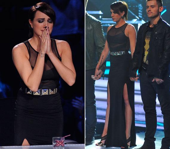 A fekete alkalmi ruhát egy fémövvel igazították a rockos stílust kedvelő énekesnőhöz illővé.