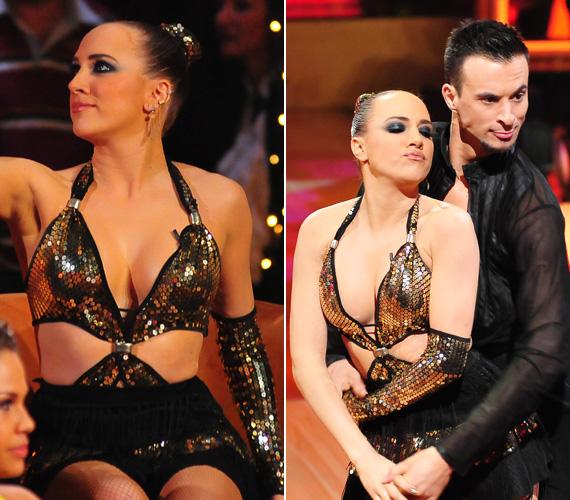 Az arany flitteres táncosruhát elnézve úgy tűnik, nem bántak bőkezűen az anyaggal.