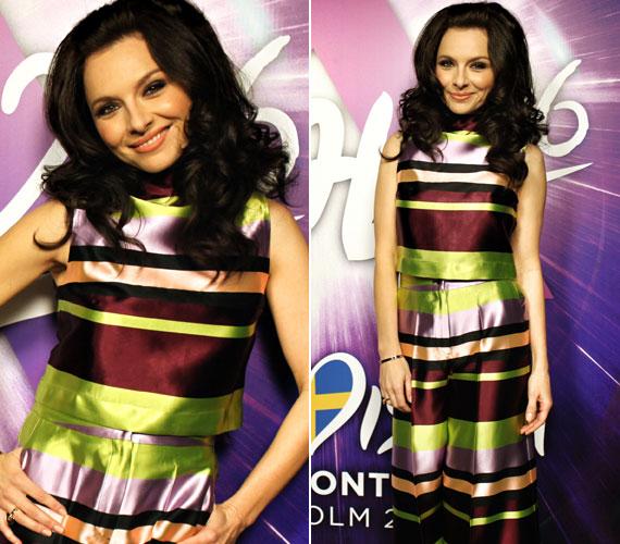 A második elődöntőben viselt vidám, tarka ruha Tomcsányi Dóra 2016-os őszi/téli kollekciójából származik - kifejezetten az énekesnő számára alkotta meg ezt a színes összeállítást.