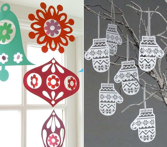 Az egyik legegyszerűbb lehetőség, ha papírból karácsonyi dísz formákat, esetleg pici kesztyűket vágsz ki, majd damilra, illetve cérnára kötözve fellógatod őket. Bájos megoldás.