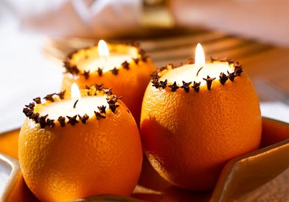 Ha már úgyis narancsot pucolsz, egyet igazán feláldozhatsz a dekoráció kedvéért. Vágd le a tetejét, vájd ki a közepét, és ültesd bele a mécsest.