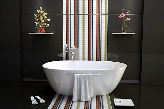 A trükkösen elrendezett csempék optikailag tágasabbnak mutatják a fürdőt - az ajtóban állva úgy tűnik, mintha a szemközti fal jóval távolabb lenne.