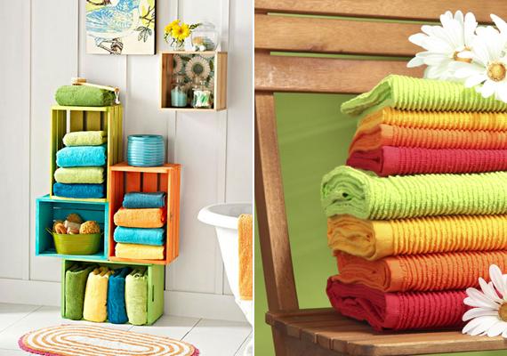 Ha egyszínű a fürdőd, színes dekorációs elemekkel is játszhatsz, a képen látható tárolódobozok például gyümölcsösrekeszekből készültek. De, ha egyszerűbb megoldást keresel, színes törölközőket is összeválogathatsz: akár egy egyszerű, régies hatású, fából készült széken is elhelyezheted őket.