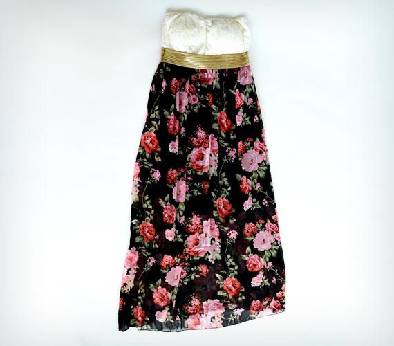 Ez a hosszú, mellrész alatt szabott, pánt nélküli ruha a széles csípőt is elrejti.A ruhát az AsiaCenterben találod, ahol 3800 forintért lehet a tiéd.