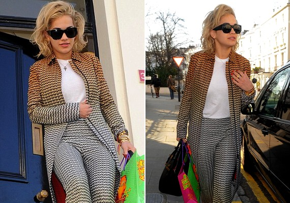 Rita Ora másnap reggel napszemüvegben, az előző napi ruhájában, de láthatóan boldogan távozott a futballügynök házából.