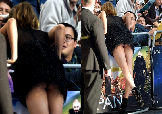 Cara Delevingne ruhája amúgy sem takart sokat, de amikor a színésznő előrehajolt a rajongókhoz, kivillant a feneke.