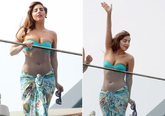 Lady Gaga egy brazil hotel erkélyéről integetett a rajongóinak egy bikinifelsőben és egy retró stílusú szoknyában.