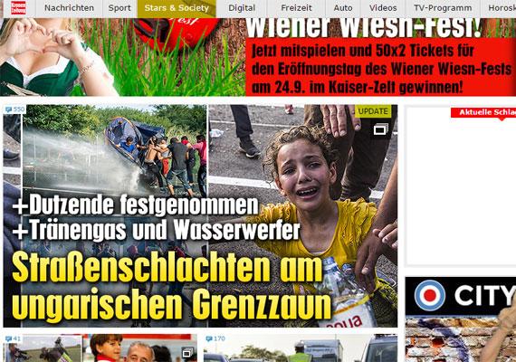 Az osztrák Kronen Zeitung is erős képpel nyit. Egy kislány láthatóan sokkos állapotban zokog a kamera előtt. A vízre valószínűleg azért volt szükség, hogy lemossák az arcáról a könnygázt.