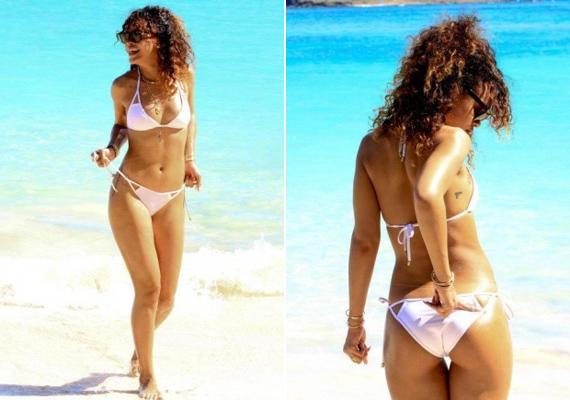 Rihanna fehér bikinije tökéletesen kiemeli az énekesnő barna bőrét, miközben a felső szabása révén még a melleit is megemeli egy icipicit. Tökéletes választás kis keblekhez.