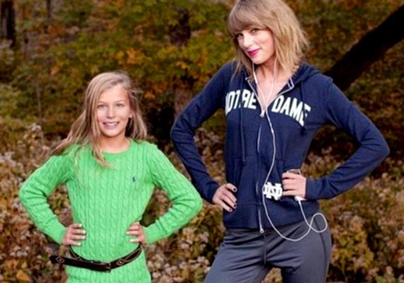 Taylor zenét hallgatott a telefonján, a fülhallgatót viszont a képek kedvéért sem vette ki a füléből.