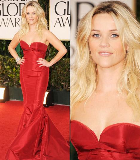Reese Witherspoon  Reese Witherspoon kerek formáit remekül kiemelte sellőszabású, vörös estélyije, melyet Zac Posennél választott. Megjelenését Fred Leighton ékszerekkel tette még sikkesebbé.