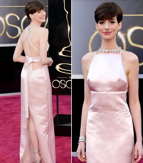 Anne Hathaway                         A Nyomorultakban nyújtott alakításáért arany szoborral díjazott színésznő egy egyszerű, babarózsaszín Prada ruhát választott a nagy eseményre.