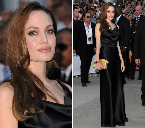 Jolie a brit tervező, Vivienne Westwood ébenfekete selyemruhájában lépett a fotósok elé, kezében aranyszínű Louis Vuitton-táskát szorongatott.