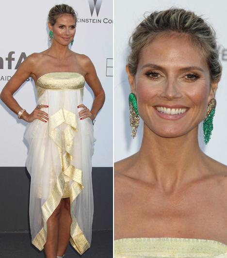 Heidi Klum                         Az egykori modellt beválasztották Cannes legrosszabbul öltözött hírességei közé aranyszegélyes ruhája miatt.