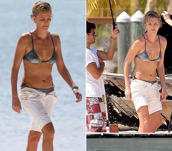 Ezüstszínű bikiniben - napernyővel kísérték, hogy fel ne égjen.