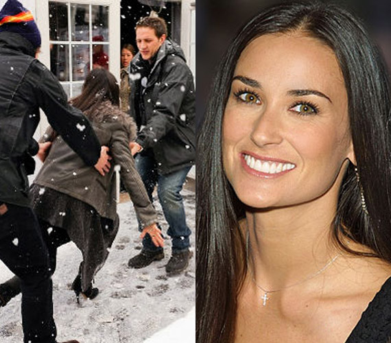 Demi Moore is férfiak segítségére szorult, amikor divatos csizmájával megcsúszott a hóban.