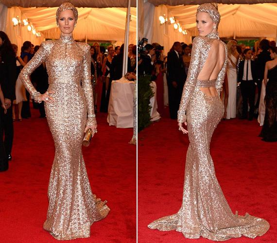 A Victoris Secret modell Karolina Kurkováról szó szerint elmondható, hogy tetőtől talpig aranyba öltözött. A ruha Rachel Zoe kreációja.