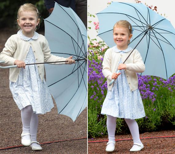 Mindenhová magával vitte kis kék esernyőjét, forgatta, nézegette, szaladt vele a kezében. A széles vigyor az őt fotózó fényképészeknek szólt.
