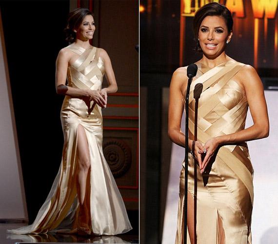 A szalagszerű, arany ruhában kivillantak formás lábai is.