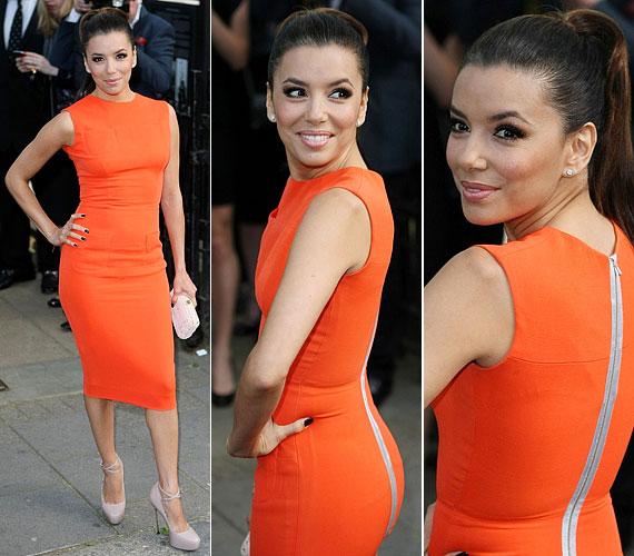 Máskor is szívesen visel élénk színeket: ebben a narancssárga, testhez simuló, Victoria Beckham kollekciójából való darabban május végén láthattuk.