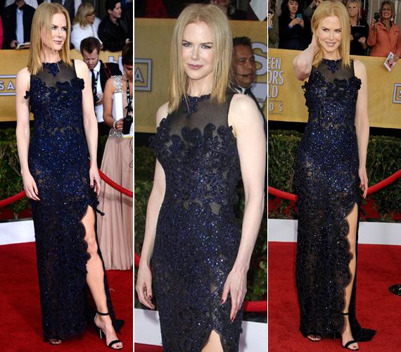 Nicole Kidman a visszafogott eleganciára szavazott a kék-fekete, csipke- és gyöngyvirágokkal díszített Vivienne Westwoodban. Hozzá egy egyszerű Manolo Blahnik tűsarkút húzott.