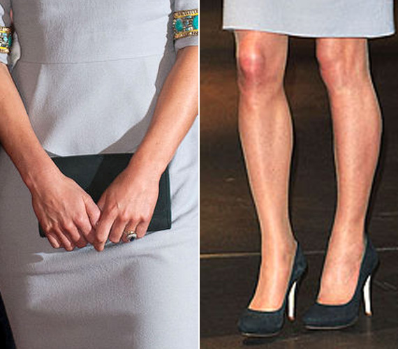 A különleges ruhához az egyszerű fekete táska és cipő volt az ideális kiegészítő. Egy gyűrűt azért még elbírt az összeállítás.