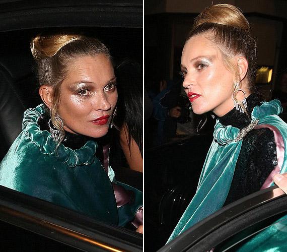 Kate Moss a londoni partira kissé eltúlzott sminkkel érkezett.