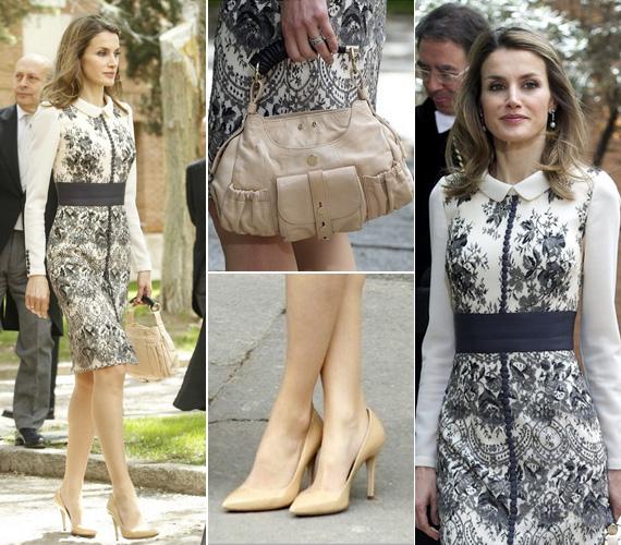 Ugyancsak a tervező kreálta a pasztellszínű selyemruhát, amelyet fekete virágok díszítenek. A táska és a ruha harmonizál a ruha alapszínével.