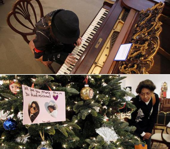 Patrice McGhee rajongó a karácsonyfa alatt hagyott ajándékokat nézi, egy másik rajongó, Kailee Lemieux pedig a popsztár egykori zongoráján zenélt.