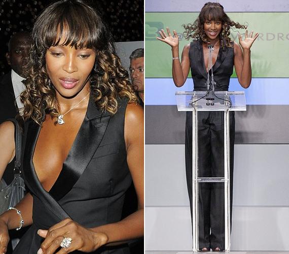 Vakmerő választás volt Naomi részéről a mellkasközépig kivágott mellény, főleg, hogy a lágy esésű kosztüm alatt melltartót se viselt.