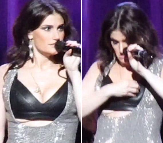 A jégvarázs sztárja,Idina Menzel koncert közben bajlódott a bőr melltartóval, amiből kibuggyantak keblei.