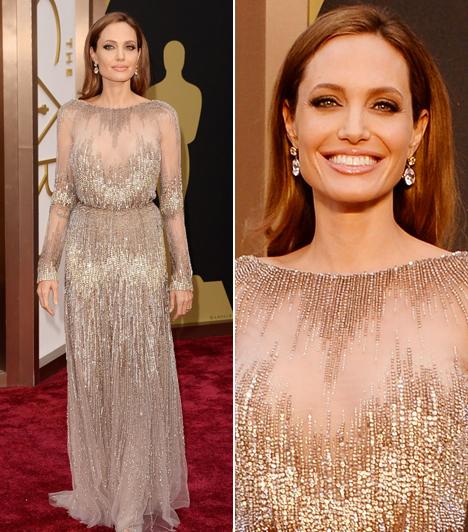 Angelina JolieA színésznő párját, a 12 év rabszolgaság producereként díjat nyert Brad Pittet kísérte el. A lenyűgöző, áttetsző felsőjű Elie Saab-darab alá nem vett fel melltartót, bár az ilyen darabokhoz nem is igen illik.