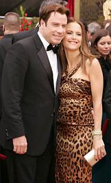 John Travolta és felesége