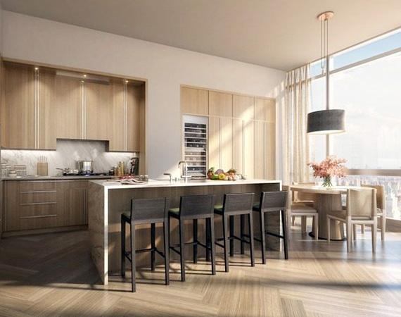 A beépített konyha minden luxussal felszerelt, a konyhapultnál és egy kis különálló asztalnál is lehet étkezni a lakóknak.
