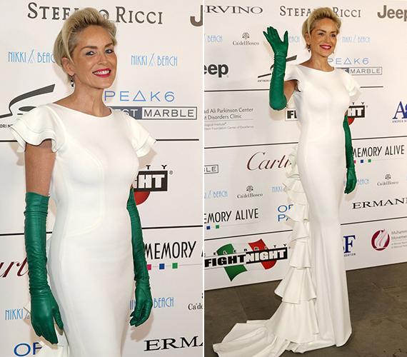 Sharon Stone láthatóan élvezte a fotósok felé irányuló figyelmét, hiszen tudta, egyszerűen mesésen áll rajta a feszülős ruha.