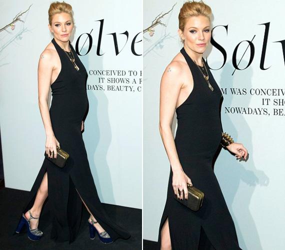 A fekete ruhát egy igencsak magas sarkú, kék cipővel, valamint gyönyörű bronz ékszerekkel és táskával dobta fel.