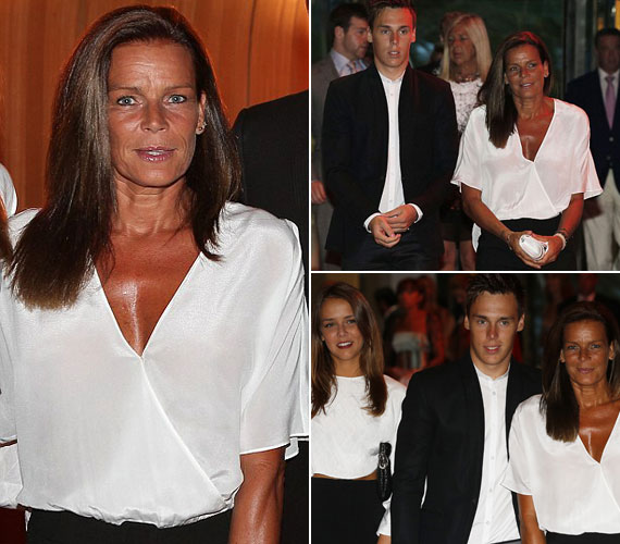 Fekete-fehérbe lánya, Pauline Ducruet és fia, Louis Ducruet társaságában. A fehér szín csak még jobban kiemelte túlzott barnaságát és ráncait.