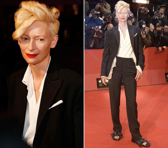 A Grand Hotel Budapest egyik szereplője, Tilda Swinton Schiaparelli 2014-es tavaszi coutur kollekciójából választott öltözetet. Nem is annyira a férfias darab, mint a tollas papucs volt bizarr.