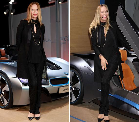 Az autónál már csak ő a dögösebb: Uma Thurman hosszú lábaival büszkén pózol a BMW előtt.