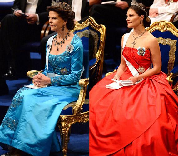 A királyné kedvenc színe a kék, így ebben jelent meg. Viktória pedig egy vörös ruhában nyűgözte le a vendégeket.